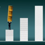 Businessman carrying a coin stack on a financial graph
